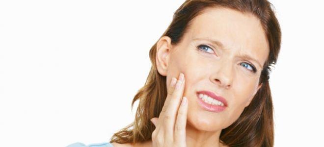 Почему болит десна возле зуба