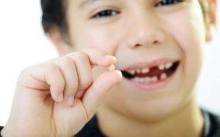 Корень молочного зуба остался в десне
