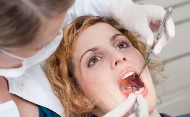 Причины возникновения боли переднего зуба
