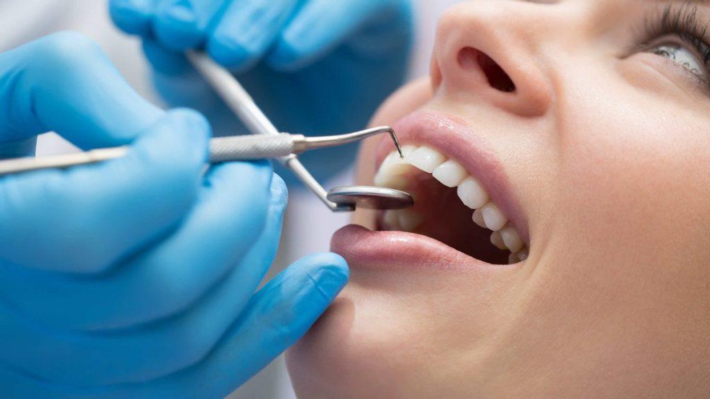 Шатается зуб - что делать, причины